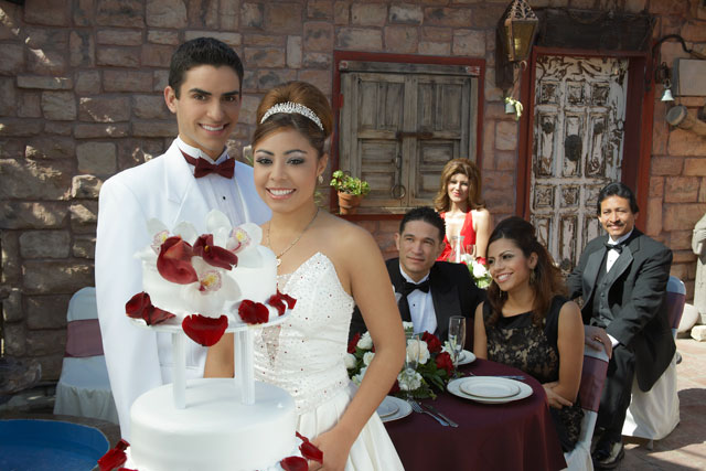 young hispanic couple celebrating wedding with parents