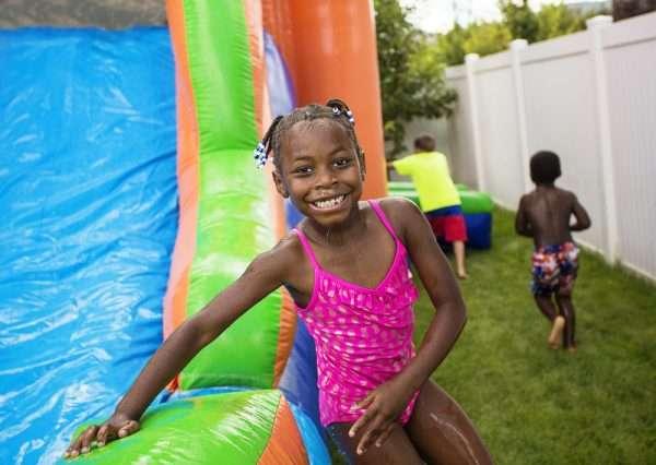 Little-girl-smiling-Inroduction-to-water-slide-rental-rules