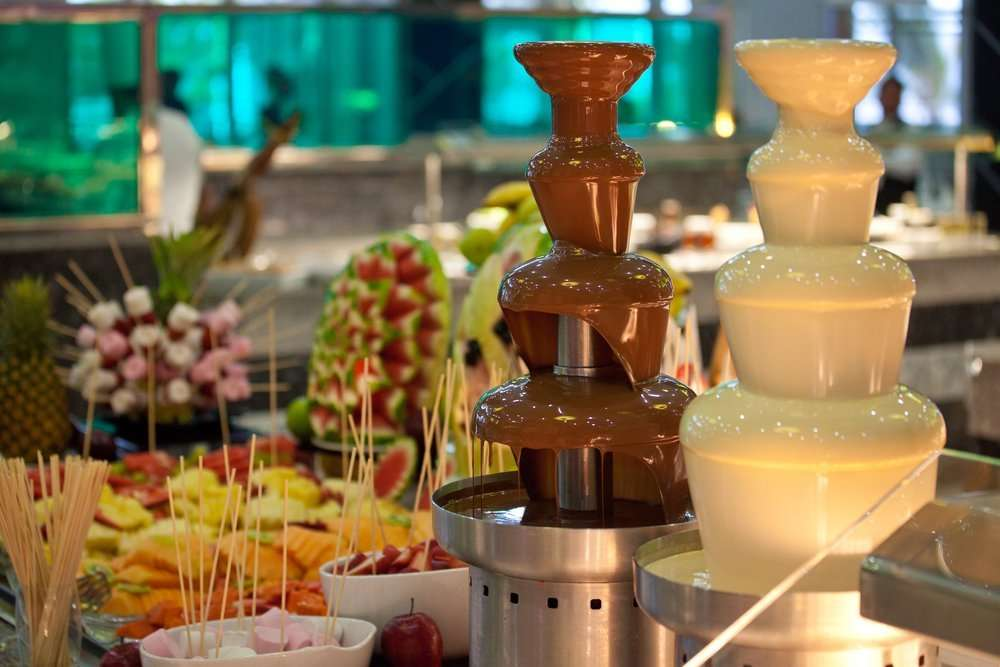 Two types of Chocolate fountain with fruits