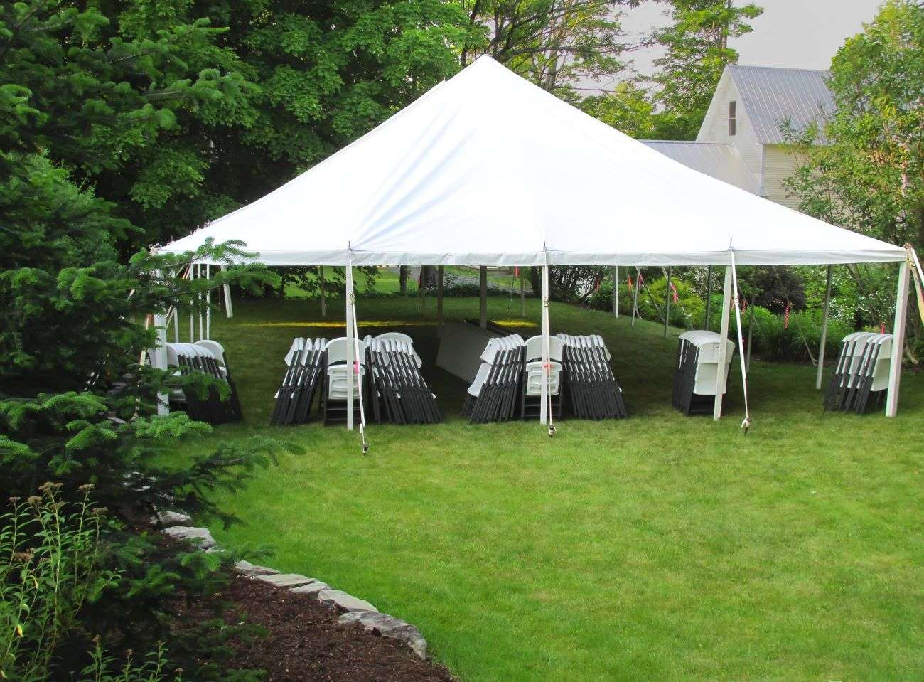 White event tent with chairs