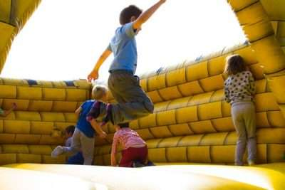 Kids playing inside a bounce house rental Miami