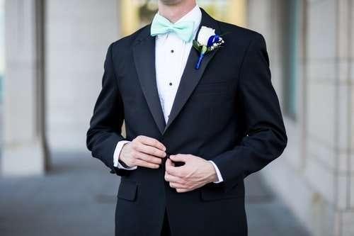 man-wearing-black-and-teal-tuxedo