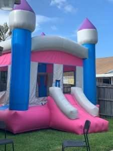 Pink inflatable castle rental